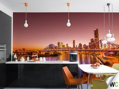 A colourful wall mural of Brisbane's city skyline at sunset. Photo by Travis Longmore and available as a wall graphic on the Wallcreations website.
