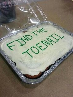 """Find the Toenail  A cake with """"Find the Toenail"""" written in frosting on it."""