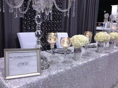 Wedding show booth decor,  Silver, crystal  white wedding head table example.