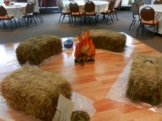 Campfire Crafts- 4 hay bales and a pop-up fire.  Then some cowboy crafts we had a cowboy do it yourself frame and color-me horses.  I hit up the dollar store for the crafts.  Later it can turn into Campfire musical chairs.