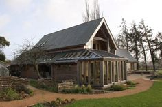 Barn house with wraparound conservatory and recessed balcony. By Roderick James Architects