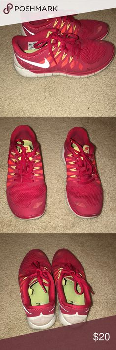 Red Nike free runs Well loved shoes still a lot of life left women's size 8. Mainly red with some orange and neon yellow Nike Shoes Athletic Shoes