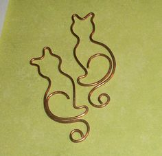 Copper Cat Charm Scrapbook 4pc by WickedlyWired on Etsy, $9.00. Could use this one line approach as a quilting motif too!