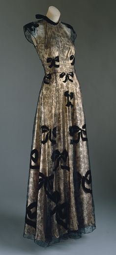 Evening gown, 1939 Madeleine Vionnet (French, 1876–1975) Pale pink lamé and black silk lace appliquéd with black silk velvet