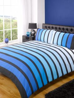 Soho Printed Duvet Cover Set. Sailor stripes in varying shades of sea and sky blue make a great eye catching centrer piece for a nautical themed room.