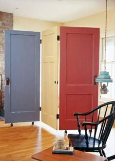 Easy Room Decorating Ideas: Hinge painted doors together and put them on wheels to make a room divider....Clever....