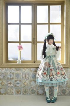 Lolita Fashion Featuring Eau de Nil With White. Kittens look ready to eat the cupcakes. #Stockings #Bows