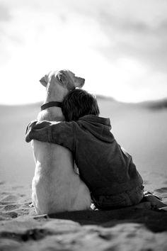 Boy and dog on beach