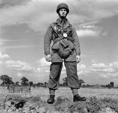THE PARACHUTE REGIMENT IN TRAINING, RINGWAY, AUGUST 1942. A paratrooper armed with a Sten gun equipped for a jump.