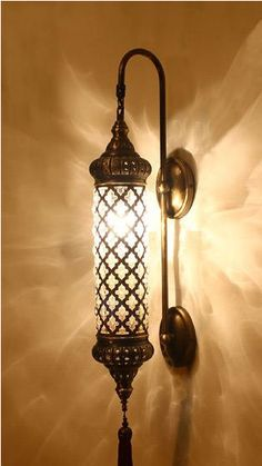Absolutely Stunning! As is everything by IstanblueDesign. This Turkish ottoman wall lamp is handmade and laser cut. Must have one of these above a night stand.