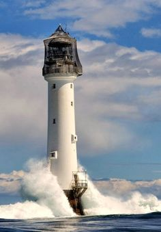 The Bell Rock Lighthouse, off the coast of Angus, Scotland, is the world's oldest surviving sea-washed lighthouse.It was built between 1807 and 1810 by Robert Stevenson on the Bell Rock (also known as Inchcape) in the North Sea, 11 miles east of the Firth Bell Rock Lighthouse, Lighthouse Pictures, Lighthouse Lighting, Irish Sea, Beacon Of Light, Water Tower, Places To See, Sailing, Scenery