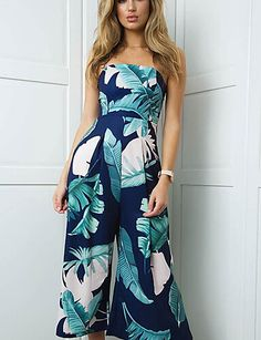 This wide leg jumpsuit is ready for vacay! It's a strapless design with a tropical palm print.