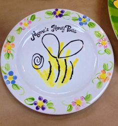 I did it! Mother's keepsake plate. Honeybee handprint.