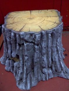DIY Tree stump. sooo cool! You could save some cash and use a cardboard box instead of a stool for party prop.