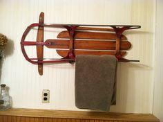 Old sled used as a bathroom towel rack.