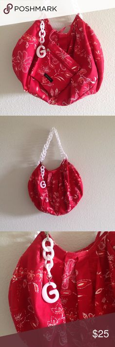 """G by Guess Hobo Bag & Coin Purse Set Red flower patterned G by Guess hobo bag and coin purse set. Plastic white chain link straps, 3 open pockets and one zippered inside, red satin lining. Coin purse and chain link """"G"""" can both be attached or unattached to purse. Fantastic condition; no stains, marks, loose threads, etc. Bag is roughly 17"""" across and 12"""" long. Coin purse is 6.5"""" square. G by Guess Bags Hobos"""