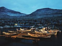 Winter sunset on the harbour-fjord of Klaksvík in the far north of the Faroe Islands. I tried going to Suðuroy but the winds had cancelled the ferry back and I didn't really feel like being stranded as far south as I could get.  #boats #boat #harbor #harbour #fjord #sunset #twilight #winter #north #beautiful #city #town #faroes #faroeislands #føroyar #klaksvik #denmark #danmark #travel #tourism #adventure #daytrip #remote #vsco #vscocam #atlanticairways #atlantic #ocean by subduction