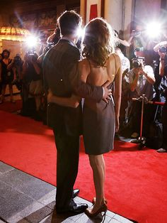 UNITED FRONT Proving they've got each other's backs, the couple sticks close together while premiering Pitt's film, The Assassination of Jesse James by the Coward Robert Ford, at the Toronto International Film Festival in September 2007.
