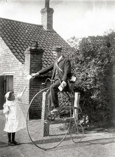Postman on a penny farthing by British Postal Museum & Archive, via Flickr