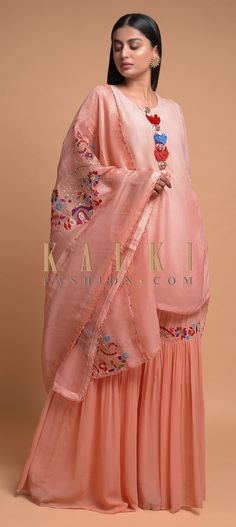 Buy Online from the link below. We ship worldwide (Free Shipping over US$100)  Click Anywhere to Tag Melon Peach Sharara Suit With A Short Kurti In Crushed Crepe Having Ruffle Sleeves Online - Kalki Fashion Melon peach sharara suit in georgette with short kurti in crushed crepe.Embellished with tassels on the placket.Crafted with round neckline and ruffle sleeves.