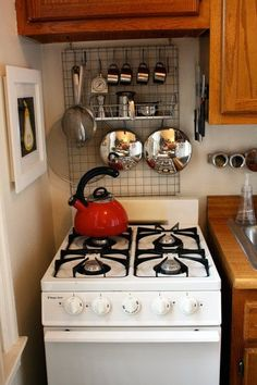 The hanging system behind the stove could be used in lots of places. ~Matt's Spirited Studio