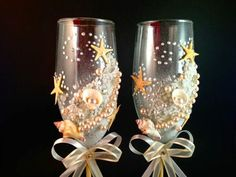 These shell embellished glasses would be perfect for the wedding toast at a beach themed wedding