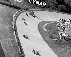 The field head around the notorious Monza banking - used for the last time in a Formula One event. Italian Grand Prix, Monza, 10 September 1961. World © Phipps/Sutton