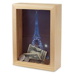 "I Have A ""Dream Bank"". Buy a shadow box, put a picture of your dream vacation destination in it, cut a slot at the top, and start saving for your trip."