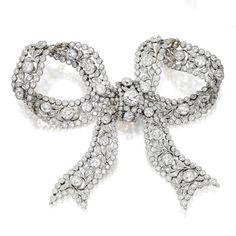 Platinum, gold and diamond bow brooch