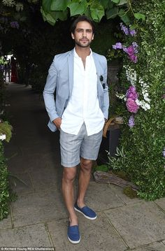Stylish: Skins actor Luke Pasqualino also joined in on the fun, looking suave in grey shorts a crisp white shirt and a pale blue blazer