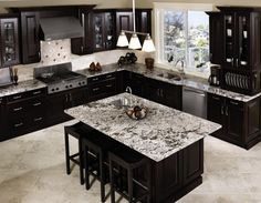 Black Cabinets with grey granite. with Stone blue walls, would have to do grey wood tile floor with less 'design' in the grain Black Kitchen Cabinets, Black Kitchens, Home Kitchens, Granite Kitchen, Kitchen Island, White Cabinets, Espresso Cabinets, Kitchens With Dark Cabinets, Interior Design Kitchen