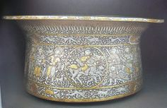 Fig. 148. Basin known as the Baptistere of Saint Louis. Materials: Brass inlaid with gold & silver. Year/Era: 1300. Location: Mamluk Egypt or Syria. Use: Catching waste water. Significance: Having no inscription bands and decoration comprised of extraordinary detail & superbly executed figural compositions, it is likely that the images substitute for inscriptions; the Baptistere represents the final use of this tradition of decoration in Islamic lands. Page 277 (Shelley C)