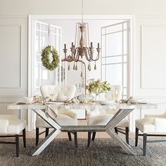 Shop the Petra Century Marble Dining Table at Arhaus-cool table base, but top is not large enough.  My furrniture maker could build base and we could add a glass top...
