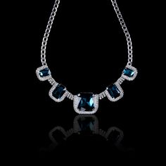 Into the Blue Necklance  Elegant in its simplicity, Rhinestones necklace complements the classic deep blue gems.