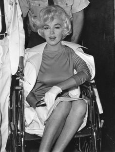 Marilyn leaving the Polyclinic Hospital after the removal of her gall bladder, 11 July 1961.