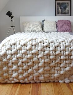 Chunky knit throw, chunky wool blanket, giant knit blanket This is a luxurious handmade throw, which is hand knitted by me using extremely big needles and unspun merino wool. Due to natural material, traditional hand craft and extreme pattern size the throw makes your room look contemporary and cosy at the same time. It is a natural, antyalergic and enviroment friendly product. Merino wool is the softest and finest kind of wool. The material is extremely breathable and regulates body…