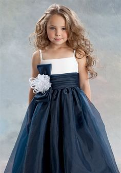 Shown in Navy and White…Floor length Navy organza skirt with draped waistband. Bow and Flower accent waist. White organza bodice with spaghetti straps. Available in ankle and floor lengths.