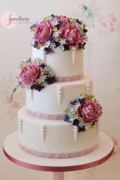 Beautiful wedding cake with ribboned edges and floral detail.  Very pretty cake.   ᘡղbᘠ