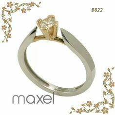 Anillo de compromiso: oro blanco, 14K, acabado en bisel y montura de oro amarillo con un precioso diamante.