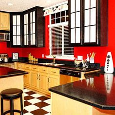 Not really digging the checkered floor. Loving the cabinets though and of course the red walls!