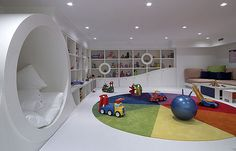 OMG adorable and FUN kids playroom, I'd pop more color in but the architecture and shelves are wonderful!