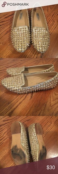 Steve Madden slip on gold glitter flats Steve Madden slip on gold glitter flats with gold studs. Worn, in good condition. Size 8.5 Steve Madden Shoes Flats & Loafers