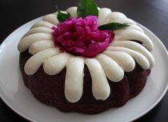 1 pkg red velvet cake mix 1 pkg instant choc pudding mix 1 c sour cream 1/2 c water 1/2 cup oil  Blend all ing's on low speed then on high for 1 min  Pour batter into greased bundt pan. Bake at 350 for 45-50 mins. Cool on a rack. Should release from the pan easily after 15 mins. Cool completely before frosting  FROSTING 2- 8 oz pkgs cream cheese soft 1/2 c butter, soft 3-4 c pwd sugar 1 T vanilla  Blend butter & cream cheese til smooth. Add vanilla & pwd sugar, one cup at a time.