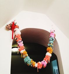gorgeous pom garland by ashely g. nts the common collective! ashley g's garland is far prettier than what was in my head. via design sponge.