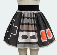 gochaserabbits:    Retro Video Game Controller! Available on GoChaseRabbits, Etsy    A collaboration between GCR and I.  She's made this fab fab fab skirt with an exclusive fabric I created as per her request, but worry not as you can get similar geek fabrics here: http://www.spoonflower.com/profiles/retropopsugar