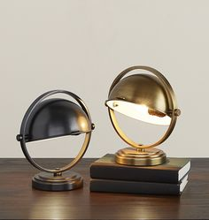 Add a touch of drama to any desktop with our Deco Accent Mini Lamp. Chic and sleek, it uses the soft curves of its Art Deco inspired pivoting shade to direct its warm glow and elegantly illuminate any workspace.  * Steel construction with brass accents * Imported