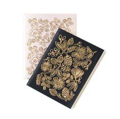 Jot down your thoughts while on the go with this pair of Gold Floral Pocket Notebooks. Each set of two features a smoky black and a rose pink notebook with blank interiors. Goil foil adorns the front a...  Find the Gold Floral Pocket Notebooks, as seen in the Soho Atelier Collection at http://dotandbo.com/collections/soho-atelier?utm_source=pinterest&utm_medium=organic&db_sku=RIF0003