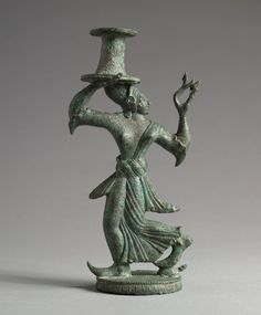 """""""Candelabrum Stand of a Dancing Maenad"""" (ca. 525-500 BCE). Etruscan, Italy. Posted on clevelandart.org."""