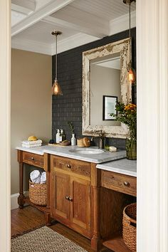 This once plain powder room was rebuilt in a vintage style featuring a custom rough-hewn vanity.