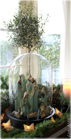 Christmas Nativity in a glass dome surrounded by greenery and star lights. Christmas Nativity Scene, Noel Christmas, Rustic Christmas, All Things Christmas, White Christmas, Vintage Christmas, Christmas Crafts, Xmas, Nativity Scenes